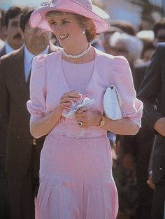 Prince Charles & Princess Diana in Sicily, Italy 1985. Her pink ensemble is by Catherine Walker. Her hat by John Boyd.