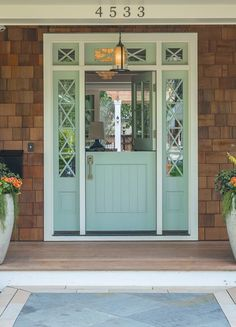 Dutch door--love the style. This is from Minn.-St. Paul show home tour, so the door can definitely handle inclement weather! via IHeart Organizing