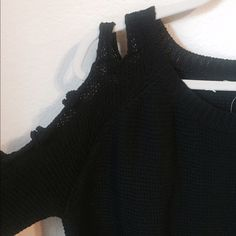 Black knit long-sleeve top with cutout arm detail Beautiful black knit long-sleeve top with cutout detail along the upper arms. It's meant to be a bit loose so although it's a size small it would fit a medium. Perfect to be worn on a night out and to be worn with long jewelry 💕 brand is GIANNI BINNI. open to offers LF Tops