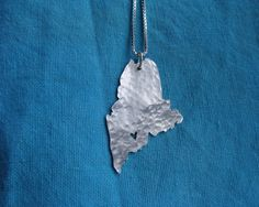FOUND IT!  Maine State Necklace. $48.00, via Etsy. The artist will put the star over whatever city or town you want!