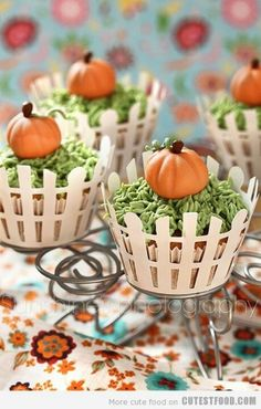 Pumpkin patch - Looks intricate but could be simple enough! Paper cut outs for fence, green frosting grass, & I'd use the candy corn pumpkins for the top.