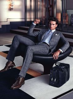 An attractive man, in an equally attractive suit is always a plus.