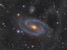 Grand Spiral Galaxy M81  11.8 million light-years away toward the northern constellation of the Great Bear.