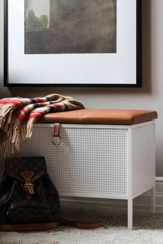 Frank is a design storage bench, designed by Louise Hederström, from Maze Interior. Available in black, white and cognac. Stylish bench for hallway, hotels or bedroom that keeps your gadgets stored nicely. Available at Maze Interior, Stockholm, Sweden.