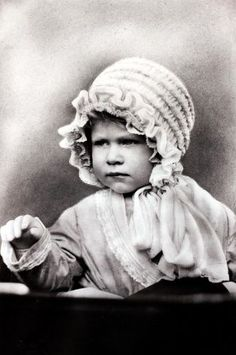 HRH Princess Elizabeth wearing a cute bonnet, the daughter of The Duke and Duchess of York. Photo: Bob Thomas/Popperfoto, Popperfoto/Getty Images / Popperfoto 1927