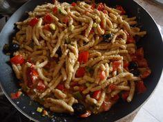 Passatelli asciutti con sugo alla crema di prosciutto e zucchine