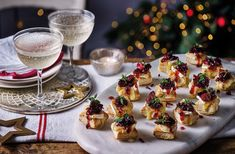 Combine classic festive flavours in this easy canapé recipe, with homemade cranberry sauce and melting Camembert. See more Canapé recipes at Tesco Real Food. Canapes Recipes, Savoury Recipes, Appetizer Recipes, Cranberry Cheese, Cranberry Recipes, Cranberry Sauce, Christmas Canapes, Christmas Nibbles, Ideas