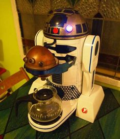 R2 D2 coffee maker haha maybe when we have a big house and neil has his own little den i'll get him this!