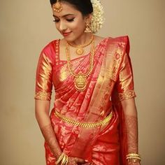 Image may contain: 1 person, standing Bridal Sarees South Indian, South Indian Wedding Saree, South Indian Bridal Jewellery, Wedding Silk Saree, Indian Bridal Outfits, Indian Bridal Fashion, South Indian Bride, Bridal Jewelry, Kerala Jewellery