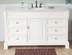 "60 Inch Single Sink Bathroom Vanity in Cream White by Bellaterra Home. $1738.00. This 60 inch modern single sink bathroom vanity is a perfect center piece for your bathroom project. This Cream White bathroom vanity features 1 door, 6 drawers, and Cream Marble with oval undermount white ceramic sink that is pre-drilled for a standard three hole 8 inch center faucet (faucet not included). Large opening in back for easy plumbing installation. Dimensions: 60""W X 2..."