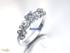 """""""Amsonia"""" - Round brilliant cut diamond with small diamonds on each band in a floral pattern. Diamond Engagement Rings, Wedding Rings, Band, Floral, Pattern, Diamonds, Collection, Jewelry, Fashion"""
