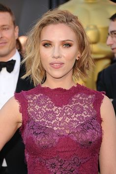 Scarlett Johansson's undefined part and beach waves would be the perfect contrast to an elegant prom dress