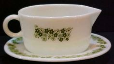 """gravy boat. or use it to pour anything comes with plate.spring blossom crazy daisy green on white colorEarly Pyrex Milk White Pyrex Glass Crazy Daisy Pattern Gravy Boat Server with matching UnderplateGravy boat server measures 3"""" H x 6 5/8"""" L x 3 3/4"""" WEmbossed on bottom 77-B PYREX Corning NY USA Safe for Oven and Microwave Not for Stove top or Broiler 8Gravy Underplate measures 1"""" H x 7 1/4"""" L x 6"""" W Embossed on bottom 77-U PYREX Corning NY USA Safe for Oven and Microwave Not for Stove Top…"""