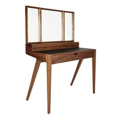This striking, sculptural Kingston Dressing table is crafted from walnut wood and was designed by Sean Dare exclusively for The Conran Shop.
