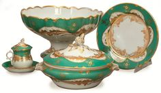A French Assembled Green and Gilt Decorated Part Dinner Service