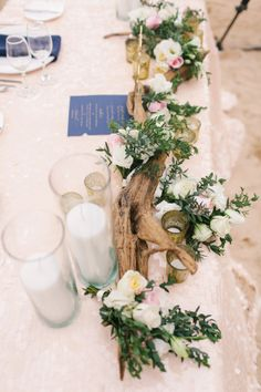 Driftwood and floral centerpiece for beach wedding - Style Me Pretty