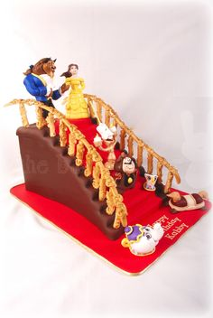 """Beauty and the Beast staircase cake - This cake was commissioned by a guy who wanted to give his Beauty and the Beast-loving girlfriend an epic cake for her birthday. Cake is almost 15"""" tall, with everything edible save for some armature wire in the banister and some figures."""