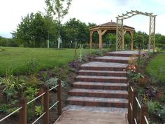 This is our wonderful creation at Laceby Manor Golf club. Its a wedding reception area with oak pavilion, bridge, monument, pathways, archway and lots of planting! www.johncavill.co.uk