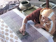 The block print technique involves a hand-carved stamp that is repeatedly applied to fabric to create a patterned textile. #blockprint #technique #stamp #fabric #-patterns