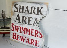 Shark bite sign, nautical nursery, beach decor, surf nursery shark theme Cute sign for the boys room Surf Nursery, Nautical Nursery, Themed Nursery, Nursery Room, Nursery Ideas, Pool Signs, Beach Signs, Beach House Decor, Diy Home Decor