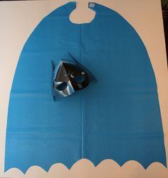 DIY capes: cut out of blue or black plastic table clothes and add a square of Velcro