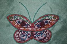 Learning to pin-the butterfly will be stretched in an embroidery hoop and used as a wallhanging