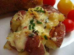 These potatoes are so easy to make, a really great addition to any meal. I think it brings the meal up a notch...just because they are so delicious and yet different. They are perfect for an appetizer as well. The regular recipe just calls for simple ingredients...potatoes,oil,salt,pepper, and a sprinkle of parsley. I chose to bring in more flavor by adding some garlic and chives. I also sprinkled some Parmesan and a bit of pepper jack cheese. I noticed that the melted cheese holds the…