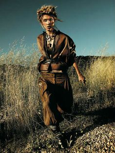 """Marie Claire. Into the Wild: Farewell, spring's sweet pastels — fall is all about primal instincts. Onward warrior princess in a second skin of shearling, leather, and suede. """"Brush Fire"""". Photo Credit: RENNIO MAIFREDI, Model: Emily Senko. --- Love the lighting and the overall atmosphere."""