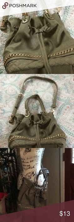 Nice gently used purse by Soul Society Cute taupe handbag/cross body with detachable strap. Lining is a fun pinstripe – gold accents on the front – fun chain decor. Bottom of bag front is faux quilted soul society Bags
