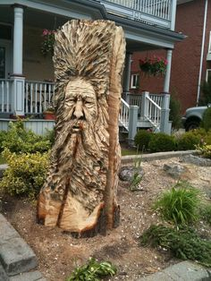 Spirit face chainsaw carving by Paul Frenette.