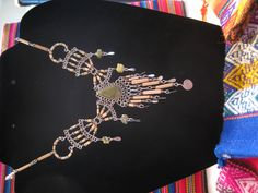Bamboo links with peridot green stones and chips. Very native/tribal looking. $18