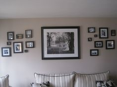 """The Wedding Wall"" -All Black & White Wedding Photos made up of frames of all different styles and sizes. Really good idea"