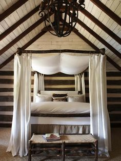 HGTV''s color palette of Rustic Romance. With a room as boldly constructed as this log cabin bedroom, minimal color sets off the dramatic building style. Echoing the white plaster between rough-hewn logs, all-white bedding and bed hangings add a no… More