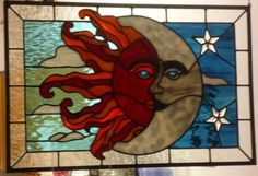 Taken from outside at dusk: I loved making this piece because of the extreme opposite colors.  It has become one of my favorites.  I've been doing stained glass for four years.  Each