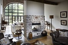 A unique Somerset family home, formally an old brewery, offering high ceilings, exposed stone walls and a light, contemporary classic interior.