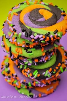 "Swirly Halloween Cookies - @Rebekah Ahn Ahn Mannix - O & H would probably have a blast making these with you! They can both mash the food coloring into the cookie dough, and O can help roll the ""snake"" out of it. :)"