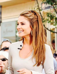 Maria Menounos. Love her pep as an Extra interviewer, but hard to picture her as a pro wrestler... Rocking such a cute sidebraid here!