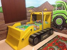 My sons construction theme room. I painted murals on the walls and built a bulldozer bed.