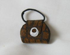 Brown and black leather  miniature handbag with silver trim 12th scale doll house. via Etsy.