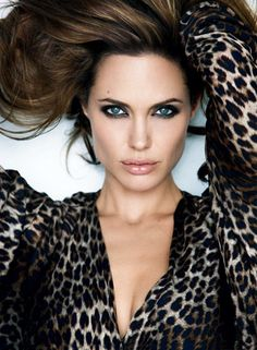 Angelina in leopard. Natural lip make-up with heavy eye make-up.