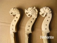 Hand carved dragon violin scrolls made from  Russian wood. Love the one of the far left!