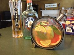 Gratzi Collins  3 parts grapefruit/lemon juice, 2 parts gin (or vodka), 1 part elderflower liquoer, fresh sage. Infuse, pour over ice, add club soda, enjoy!  Love my new porthole :-)