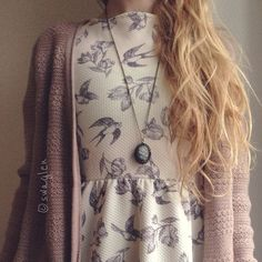 Gorgeous vintage bird pattern on a simple dress layered with a mauve sweater and a long necklace