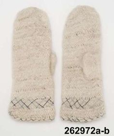 Nalbound mittens from Björkeryd, Sweden. Taken to museum collections in 1961. Length 32 cm. Decoration at the cuff with light blue and dark blue cotton yarn.