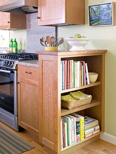 Open-Shelf Storage Solution - Boost storage and display space in a kitchen by capping off a run of cabinets with open shelves. These shelves face the adjoining breakfast room and offer a convenient spot for storing cookbooks. The shelf unit also rises slightly above the counter surface to help hide clutter.