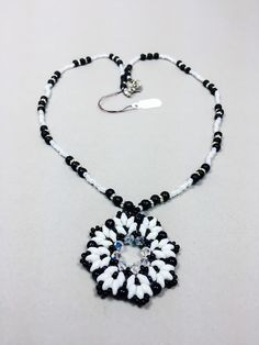 This beautiful handmade necklace is made with superduo beads in two different color black and white. Measure: 16 inches