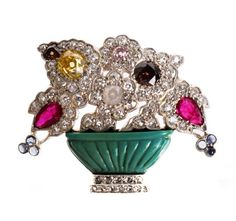 """A spectacular museum quality """"PETOCHI"""" Roma Giardinetto brooch. This rare, one of a kind piece is dated back to circa 1890, featuring an exquisite floral array of fancy coloured diamonds and natural untreated stones. The term 'Giardinetto' translates from Italian to English as 'garden'."""