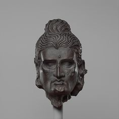 Head of the Fasting Siddhartha : Date: ca. 3rd–5th century Pakistan (ancient region of Gandhara) made of Schist.  Dimensions: H. 5 1/4 in. (13.3 cm); W. 3 3/8 in. (8.6 cm); D. 3 1/4 in. (8.3 cm)