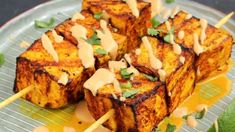 This tofu satay served with peanut sauce is a delicious vegan version of the classic Asian appetizer.