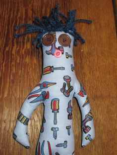 Tool Dammit Doll. Poem attached: When life has hit you by surprise, And things aren't going your way. Here's a word from the wise, Dammit Doll can help your day! Grab by the legs so tight, then find a place to smack it.  Then Shout with all your might, Dammit, Dammit, Dammit.... by tobeesgifts on Etsy, $15.95